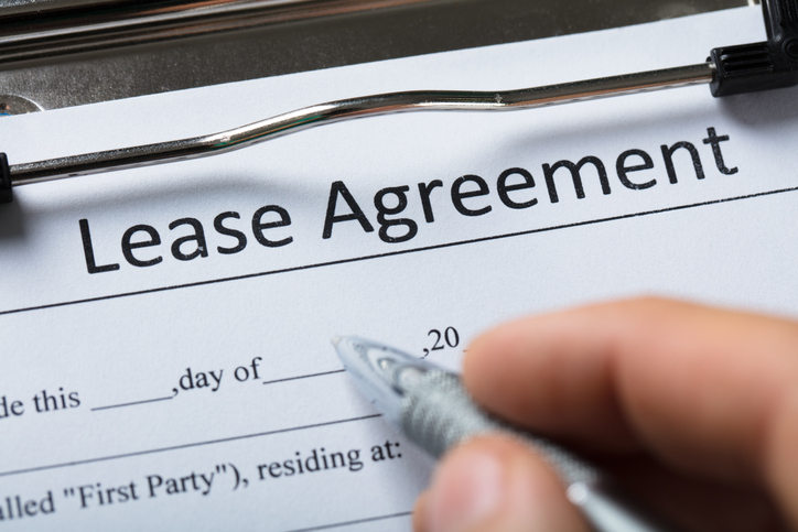 Renter Signing an Effective Property Management Lease Agreement with Scottsdale Property Manager